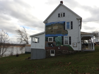 Story of the Mount House on Gagetown Island on side of house with Murals