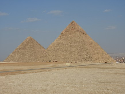Khafre's Pyramid appears larger due to higher elevation and The great pyramid (Khufu's pyramid) back