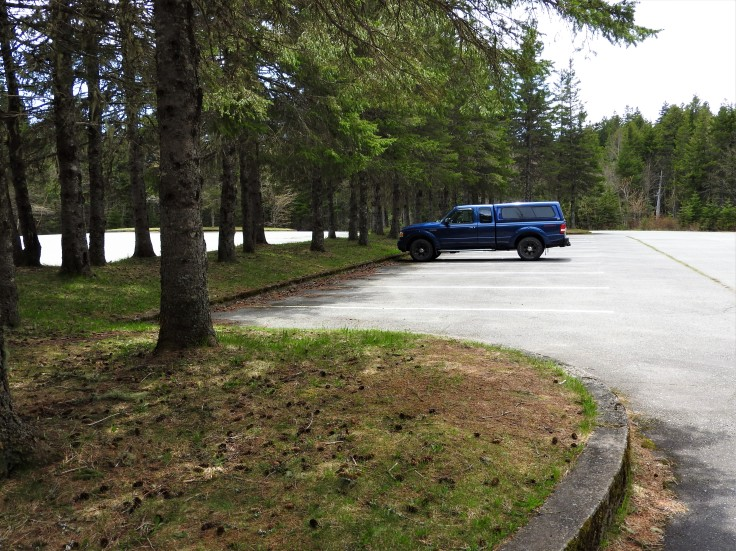 The sole vehicle in the parking lot of Bennett lake