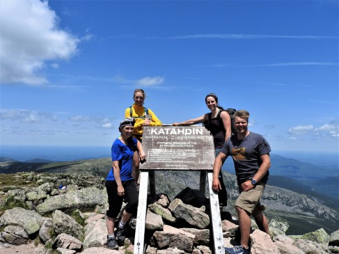 Group shot at the top with the Katahdin sign,